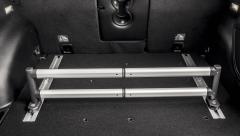Barra telescópica para organizador de maletero